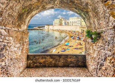 Scenic rock arch balcony overlooking Gallipoli waterfront, Salento, Apulia, Italy