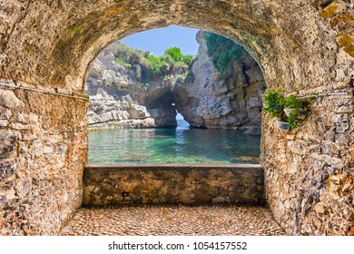 Scenic rock arch balcony overlooking an idyllic beautiful natural pool in Sorrento, Bay of Naples, Italy