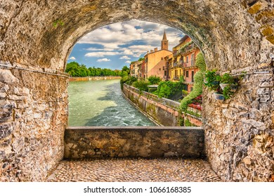Scenic rock arch balcony overlooking Adige River in central Verona, Italy