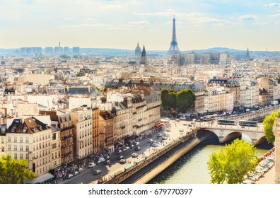 Scenic rooftop view of Paris, France, from Notre Dame Cathedral with the Eiffel Tower in the background. Colourful summer skyline. Popular travel destination.