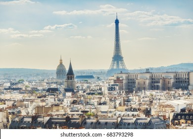 Scenic rooftop view of Paris, France, from the Notre Dame Cathedral with the Eiffel Tower in the background. Colourful summer skyline. Popular travel destination.