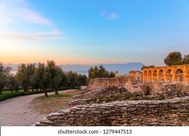 Scenic ruins in the rays of sunset of Grottoes of Catullus, roman villa in Sirmione city,  Lake Garda, Italy. Winter time.