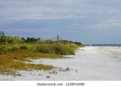 Scenic sandy white beach and blue sky at Sanibel Beach in Florida