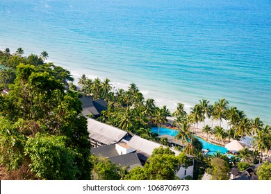 Scenic seascape of Ko Chang Island (Koh Chang), Trat Province, Thailand.  High angle view (Bird's eye) of Hat Sai Khao beach. Swimming pool by the beach and blue sea.