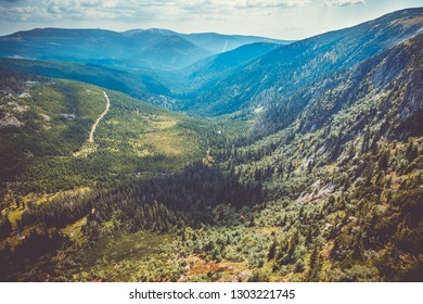 Scenic sight of czech giant mountains valley and spruce forest at summer