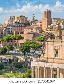 Scenic sight in the Roman Forum, with the Temple of Antonino and Faustina, the Tower of the Militia and the Trajan's Market. Rome, Italy.