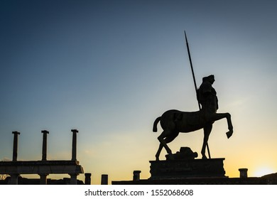 Scenic silhouette of the Centaur statue by Igor Mitoraj at Pompeii ancient city, Italy