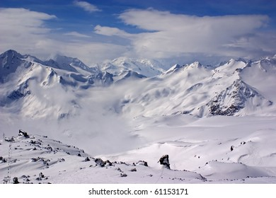 Scenic snow valley landscape showing lots of fresh snow powder in Caucasian mountains