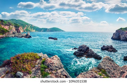 Scenic spring view of Limni Beach Glyko. Fabulous morning seascape of Ionian Sea. Splendid outdoor scene of Corfu island, Greece, Europe. Beauty of nature concept background.