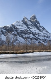 Scenic spring view on the fast mountain frozen river. Northern Norway.Troms.