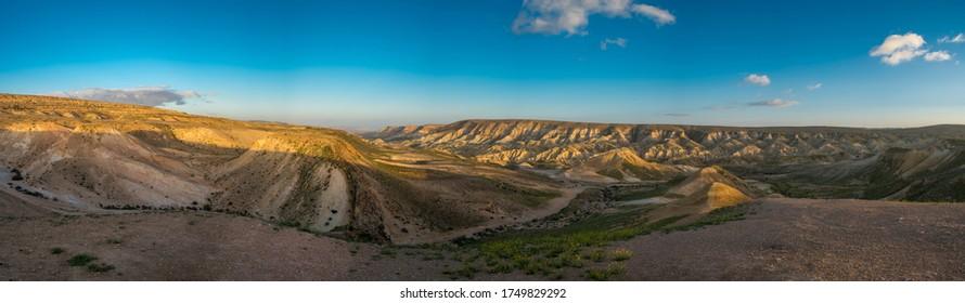 Scenic spring view of the sunset over the wadi Havarim, Avdat Canyon (Ein Avdat) and kibbutz Sde Boker in the Israel's Negev Desert, Southern Israel.