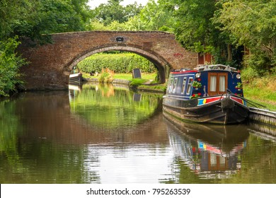 A scenic stone arched bridge stands across the Black Country Ring waterway, in the English heartland of the West Midlands.