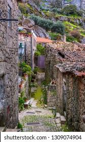 Scenic street of tge stone village of Monsanto. Portugal