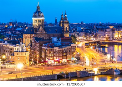 Scenic summer aerial night view of the Old Town architecture with Cathedral Church in Amsterdam, Netherlands