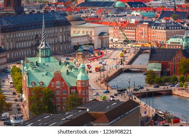 Scenic summer aerial view of Old Town skyline with Boersen and lot of red roofs, Copenhagen, capital of Denmark
