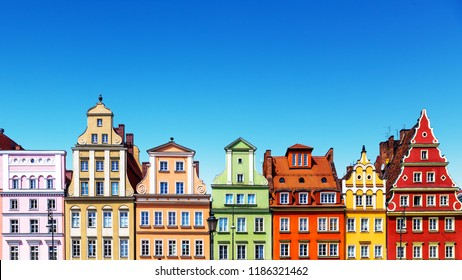 Scenic summer background view of the ancient classic color homes or houses architecture buildings with blue sky in the Old Town of Wroclaw, Poland