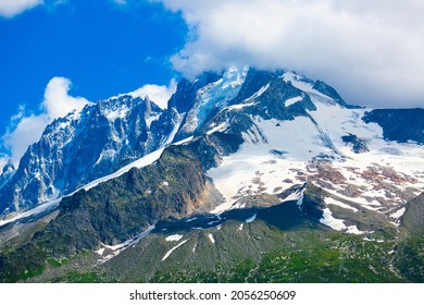 Scenic summer landscape of snow covered rocky mountain Aiguille Verte in Mont Blanc massif in French Alps