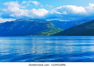 Scenic summer landscape of Sognefjord fjord in Norway, Scandinavia with high mountains, sea water and blue sky with clouds
