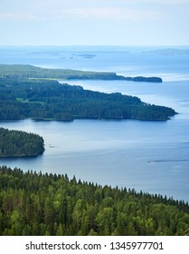 Scenic summer landscape view over the lake Pielinen from the top of the UkkoKoli, a fell at the Koli national park in Joensuu, Finland, the land of a thousand lakes.