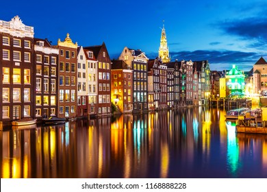 Scenic summer night view of iconic ancient medieval buildings in the Old Town of Amsterdam, Netherlands