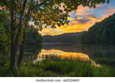 Scenic summer sunset over calm mountain lake, Appalachian Mountains