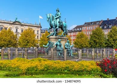 Scenic summer view of Christian V statue in Kongens Nytorv (King's New Square) in Copenhagen, Denmark