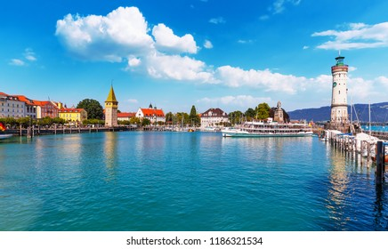 Scenic summer view of the Old Town pier architecture and ancient lighthouse tower in Lindau, Bodensee or Constance Lake, Germany