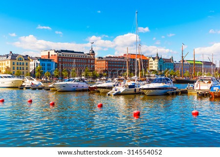 Scenic summer view of the Old Town architecture and pier with yachts and boats in the Old Port in Helsinki, Finland