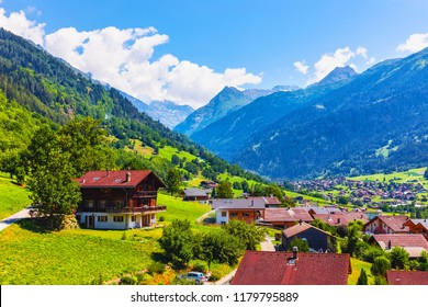 Scenic summer view of wooden cottage houses in the mountain village in Alps, Switzerland