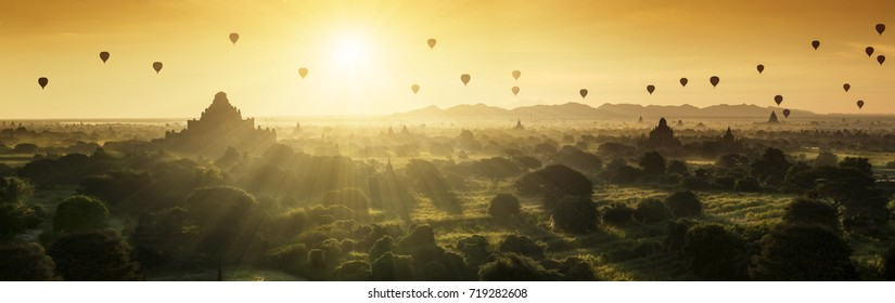 Scenic sunrise with many hot air balloons above Bagan in Myanmar. Bagan is an ancient city with thousands of historic buddhist temples and stupas.Bagan, Myanmar (Burma)