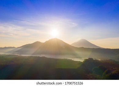 Scenic sunrise and mist at Batur volcano, Kintamani, Bali, Indonesia.