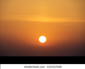 Scenic sunrise over the Sahara desert on a clear summer day. Tunisia.