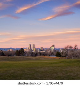 Scenic sunrise with pink clouds over downtown Denver, Colorado. Super wide angle.