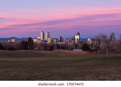 Scenic sunrise with pink clouds over downtown Denver, Colorado. Wide angle.