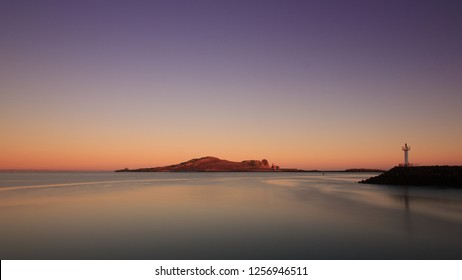 Scenic sunrise seascape of Ireland's Eye island in Howth, County Dublin, Ireland.