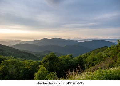 Scenic sunrise view of the Blue Ridge Mountains near Asheville, North Carolina from the Blue Ridge Parkway, a scenic byway stretching across the mountains of western NC.