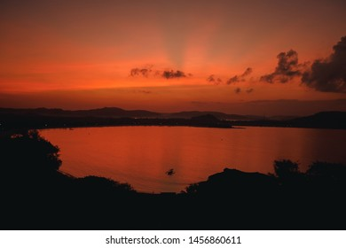 Scenic sunrise view at Merese hill, Lombok island, Indonesia.Beautiful golden sunset/sunrise over the sea behind mountains in background