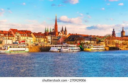 Scenic sunset evening view of old buildings at Main river pier and street architecture in the Old Town of Wurzburg, Bavaria, Germany
