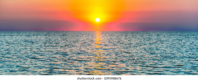 Scenic sunset on the mediterranean sea at the end of summer
