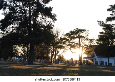 Scenic sunset over the cemetery and all the gravestones.