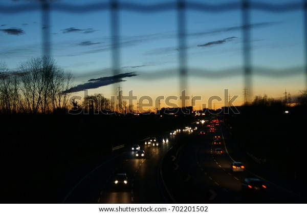 Scenic sunset over the city with highway as sean from bridge