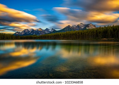 Scenic sunset over Herbert Lake along the roadside of the Icefields Parkway in Banff National Park, Alberta, Canada. Long exposure.