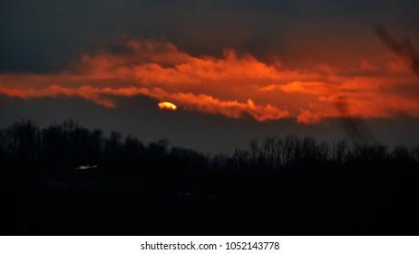 a scenic sunset over the lake Oggiono, a mere close to lake Como, Lombardy, Italy