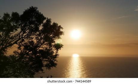 a scenic sunset over the Tyrrhenian sea near the Argentario bay, Tuscany, Italy.