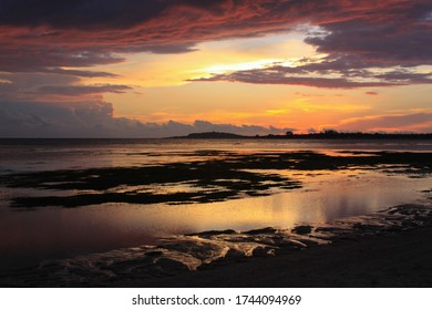 Scenic Sunset from Pantai Sejuk Pundewa beach view of Gili islands silhouette. Exotic tropical destination beach on island