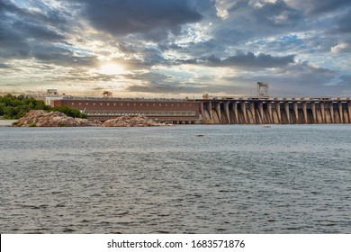 Scenic sunset view from the island of Khortytsia to the Dnieper River and Dnipro hydroelectric power plant dam in Zaporizhia, Ukraine.