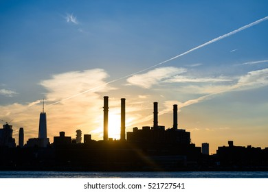 Scenic sunset view of urban Manhattan silhouette from Brooklyn on the water