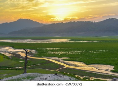 Scenic sunset at wide river valley in Jim Corbett National Park