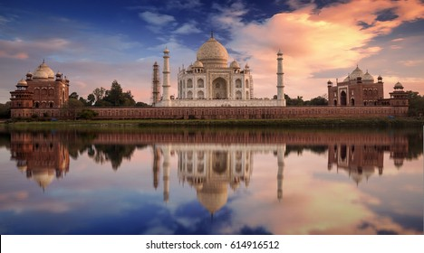 Scenic Taj Mahal sunset view from Mehtab Bagh on the banks of Yamuna river. Taj Mahal is a white marble mausoleum designated as a UNESCO World heritage site at Agra, India.