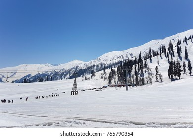 Scenic of tourists, activities, ski lift and beautiful snow at Gulmarg; a popular skiing destination and a notified area committee in the Baramulla district of the Indian state of Jammu and Kashmir.